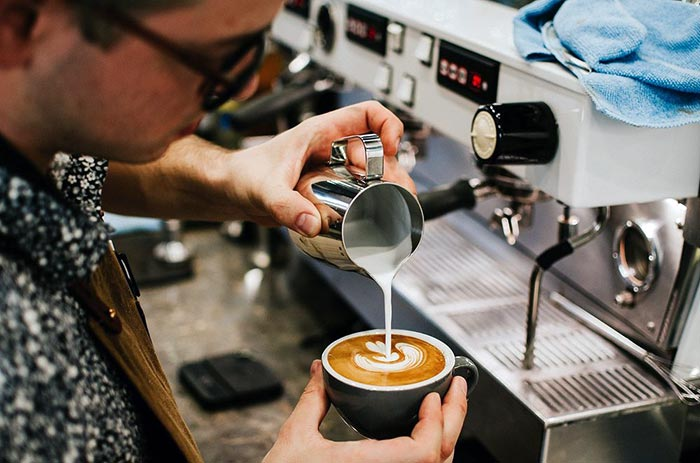 Learn to texture milk in a barista course